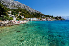 Schöner Strand und transparentes Türkis-Meer Lizenzfreies Stockfoto