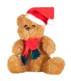 Schöner Teddybär mit Schal und Weihnachtshut Stockfoto