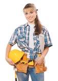 Schöner weiblicher Bauarbeiter, der hardat und blueprin hält Stockfoto