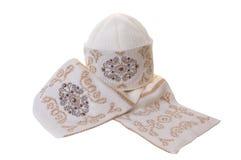 Schöner woolen Schal und Schutzkappe. Stockbilder