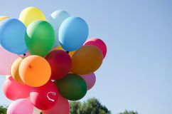Schönes Arm voll Ballone Stockfoto