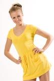 Schönes Baumuster im gelben Kleid getrennt auf Weiß Lizenzfreie Stockfotografie