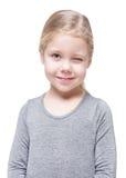 Schönes Blinzeln des kleinen Mädchens lokalisiert Stockbild