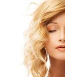 Schönes blondes Frauengesicht Stockfotografie