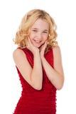 Schönes blondes kleines Mädchen, das rotes Kleid trägt Lizenzfreie Stockfotografie