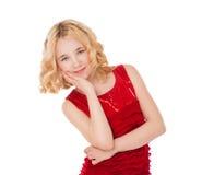 Schönes blondes kleines Mädchen, das rotes Kleid trägt Stockbild