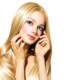 Schönes blondes Mädchen über Weiß Stockfotos
