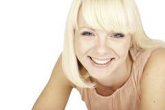 Schönes blondes Mädchen auf weißem Hintergrund Lizenzfreie Stockfotografie