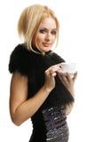 Schönes blondes Mädchen im Pelz Stockbilder