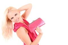 Schönes blondes Mädchen im rosafarbenen Kleid Stockfotos