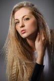 Schönes blondes Mädchen mit hellem bilden Stockfotografie