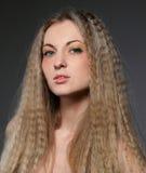 Schönes blondes Mädchen mit hellem bilden Stockbild