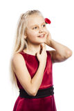 Schönes blondes Mädchen mit stieg in Haar Stockfotografie