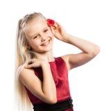 Schönes blondes Mädchen mit stieg in Haar Stockbild
