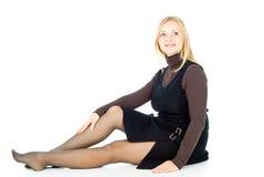 Schönes blondes Mädchensitzen getrennt Stockbilder