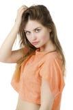 Schönes blondes Modefrauenmodell in der orange Bluse Stockbild