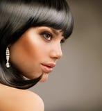 Schönes Brunette-Mädchen Stockfotos