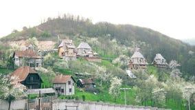 Schönes Dorf auf dem Hügel in Südost-Europa stock video footage