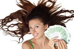 Schönes Frauenlügen und Einflussgeldeuro Lizenzfreie Stockfotografie
