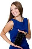 Schönes freundliches Mädchen mit einem schwarzen Fonds Stockbild