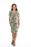 Schönes Geschäftsfrau-Mode-Modell lokalisiert auf dem Weiß, grün Stockbild