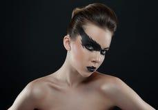 Schönes Gesicht mit dunklem Make-up Stockfotos