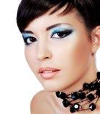 Schönes Gesicht mit stilvoller Art und Weiseaugenverfassung. Lizenzfreies Stockfoto