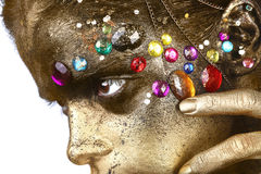 Schönes Gold gemalte Frau im Begriffsschönheits-themenorientierten Bild stockfotos