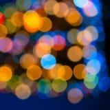 Schönes großes Zusammenfassungsweihnachtsrundschreiben beleuchtet bokeh Hintergrund, Stockfotografie