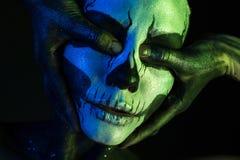 Schönes gruseliges Mädchen mit skeleton Make-up Lizenzfreie Stockfotos