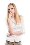 Schönes junges blondes Erwägen. Lizenzfreies Stockfoto
