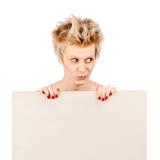 Schönes junges blondes Mädchenholdingleerzeichen Lizenzfreie Stockfotos
