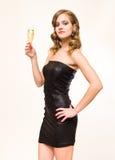 Schönes junges blondes mit Champagnerglas. Stockbilder