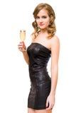 Schönes junges blondes mit Champagnerglas. Stockfotografie