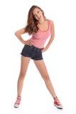 Schönes junges Jugendlichmädchen in den Denimkurzschlüssen Lizenzfreies Stockfoto