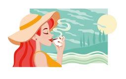Schönes junges Mädchen, das einen Tasse Kaffee oder einen Tee genoss Stockbilder