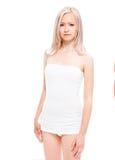 Schönes junges Mädchen in einem T-Shirt und in den Kurzschlüssen Lizenzfreies Stockfoto