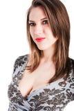 Schönes junges Mädchen in einer grauen Bluse stockfoto