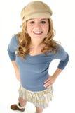 Schönes junges Mädchen im Minirock und in der Strickjacke Lizenzfreie Stockfotos