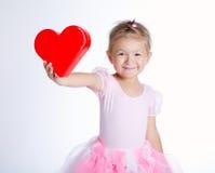 Schönes junges Mädchen mit Innerem Lizenzfreie Stockbilder