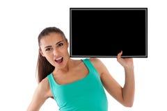 Schönes junges Mädchen mit schwarzer Anzeigetafel Lizenzfreies Stockbild