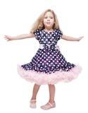 Schönes kleines Mädchen, das herum lokalisiert spinnt Lizenzfreie Stockbilder