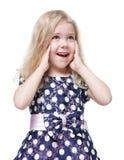 Schönes kleines Mädchen mit dem blonden Haar überrascht lokalisiert Lizenzfreie Stockfotografie