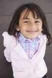 Schönes Lächeln des kleinen Mädchens lizenzfreie stockbilder
