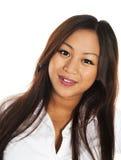 Schönes lächelndes asiatisches Mädchen Stockfoto