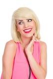Schönes lächelndes blondes Mädchen, das weg schaut Stockbilder