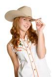 Schönes lächelndes Cowgirl stockfoto
