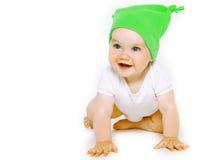 Schönes lächelndes kleines Baby im bunten Hut Stockfotografie