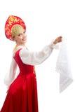Schönes lächelndes russisches Mädchen im Volkskostüm Stockfoto