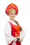 Schönes lächelndes russisches Mädchen im Volkskostüm Stockbilder